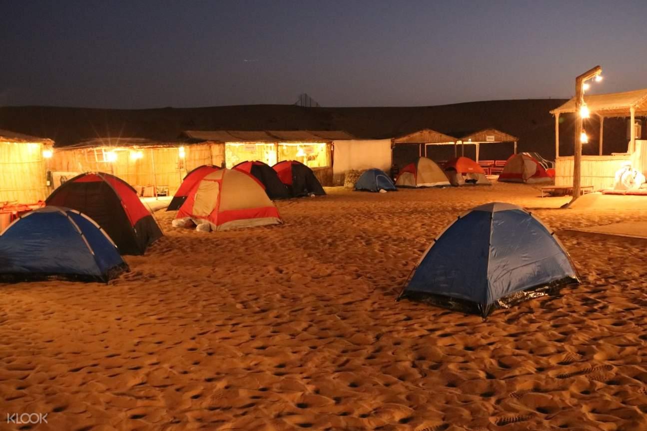 white car dune bashing during the evening desert safari
